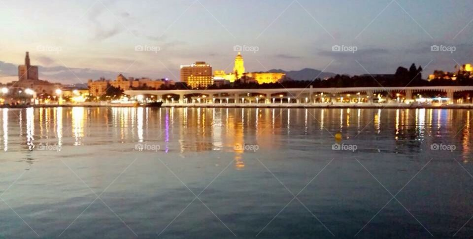 Malaga port in the dusk, early evening with reflections from the water