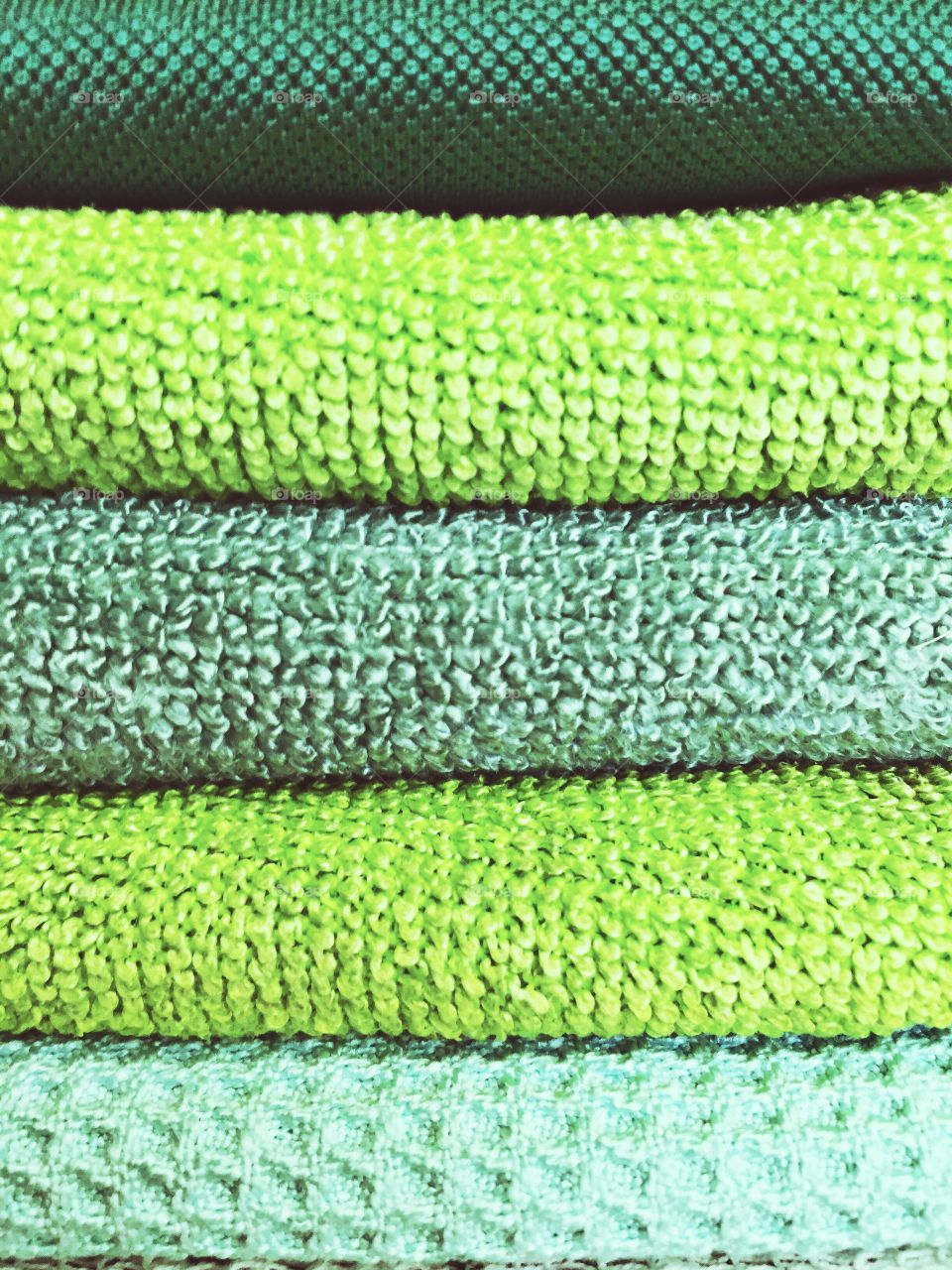 Green Color Story - Stack of folded microfiber cloths of various textures and shades of green