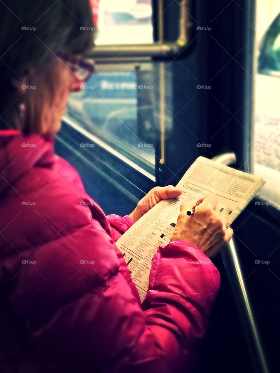 New York Times crossword puzzle on the bus