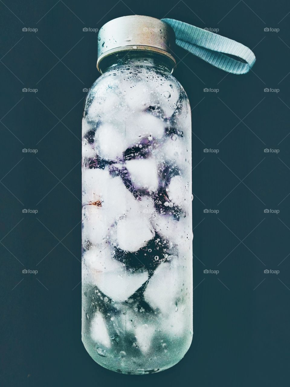 A bottle of water with ices.