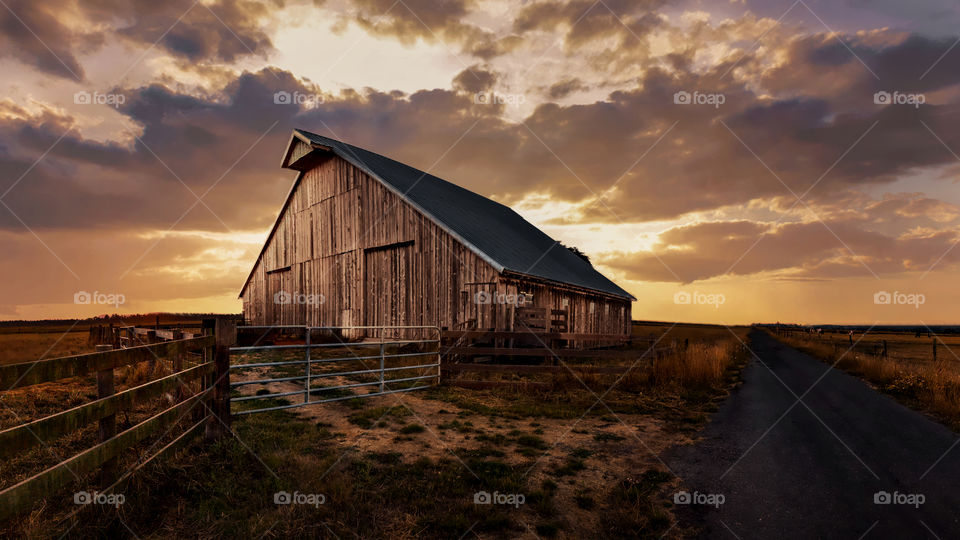 View of wooden barn at farm