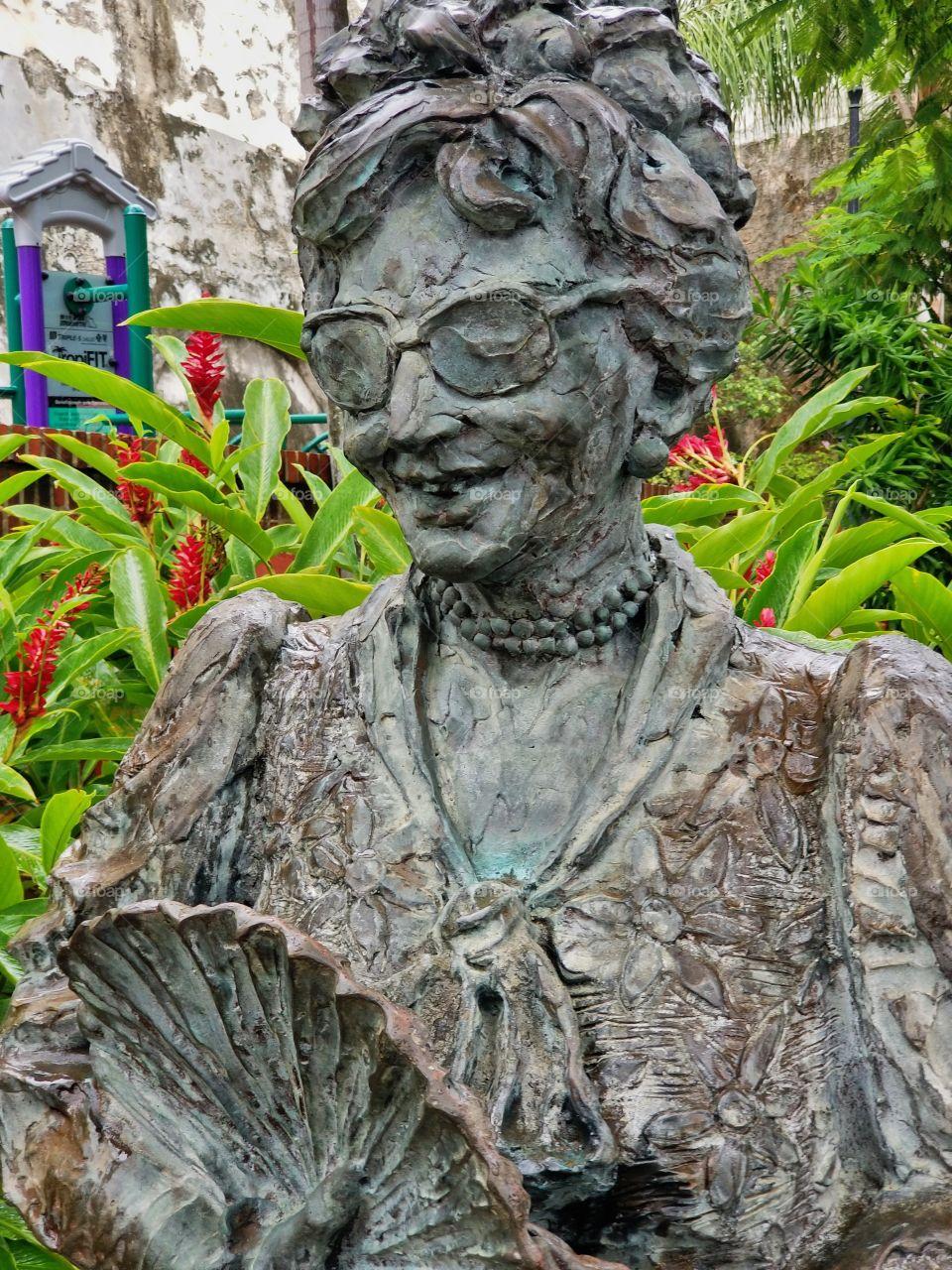 Statue looking over botanical garden..