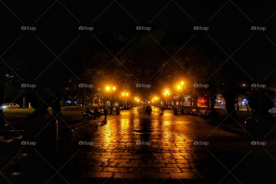 Lit up path at Lviv City Center at night.