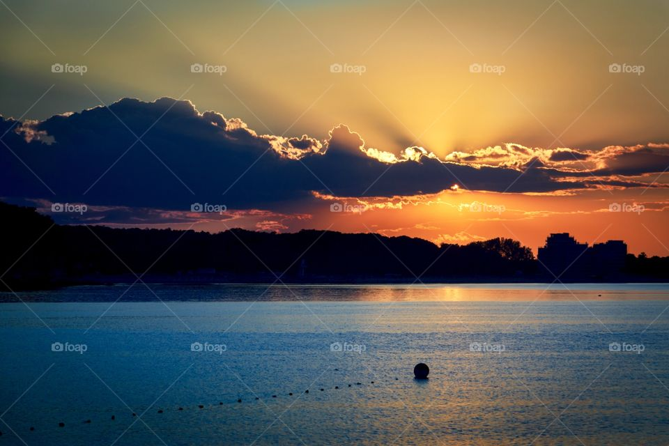 Beautiful sunset over the sea and colourful sky and sunlight