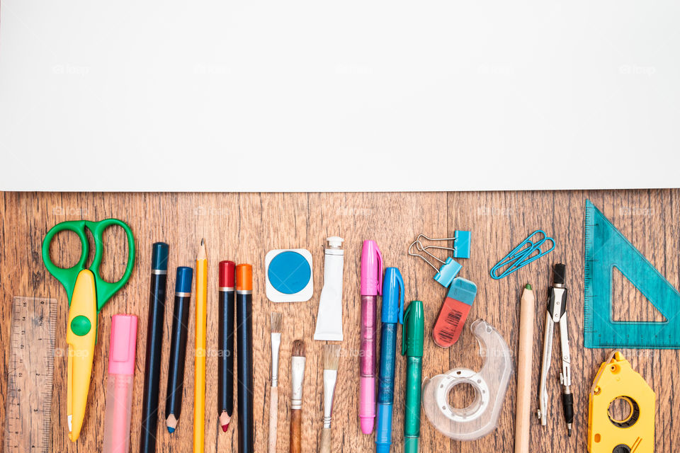 Top view of school accessories on a desk