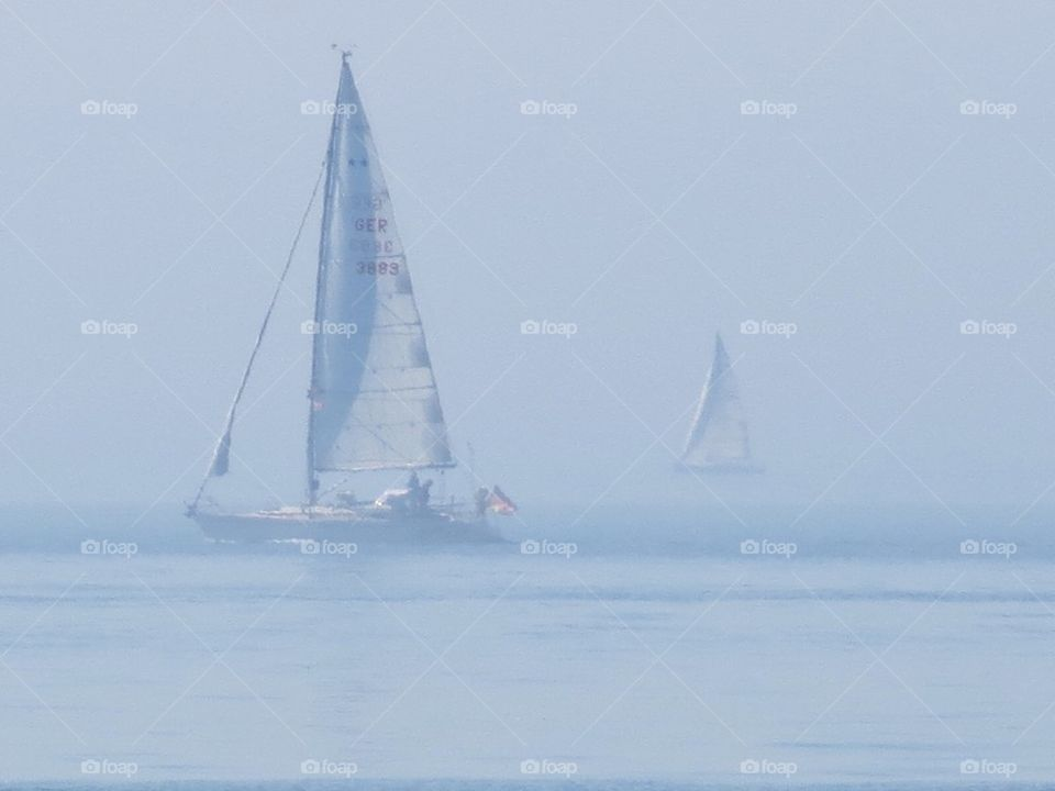 Sailboats in mist