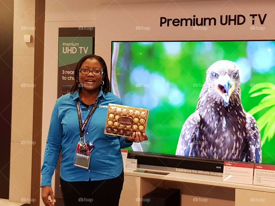 Posing with my box of Ferrero Rocher chocolates given to me by a happy customer at Peter Jones department store Sloane square Chelsea Kings road London