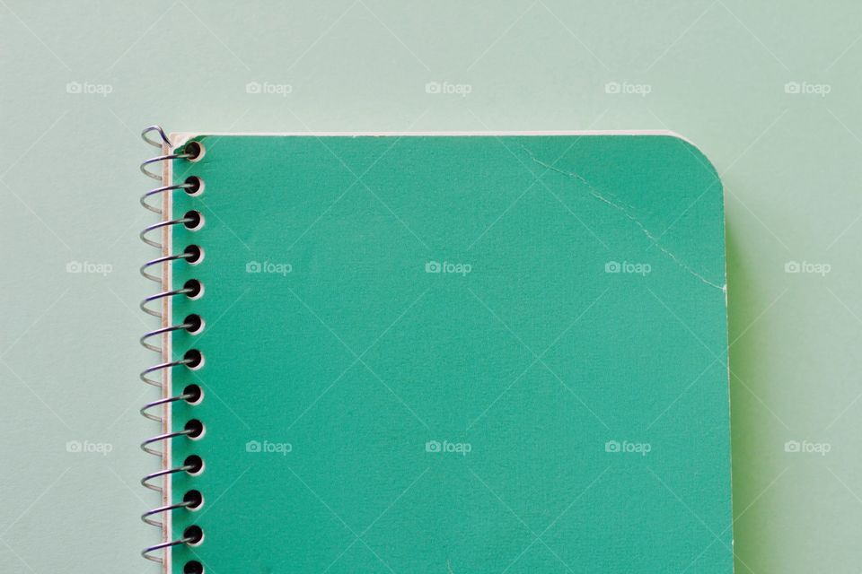 Elevated view of green spiral notebook