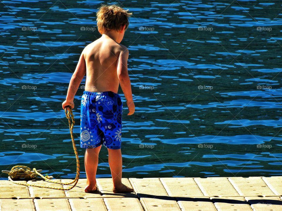 Boy Near Lake In Summer