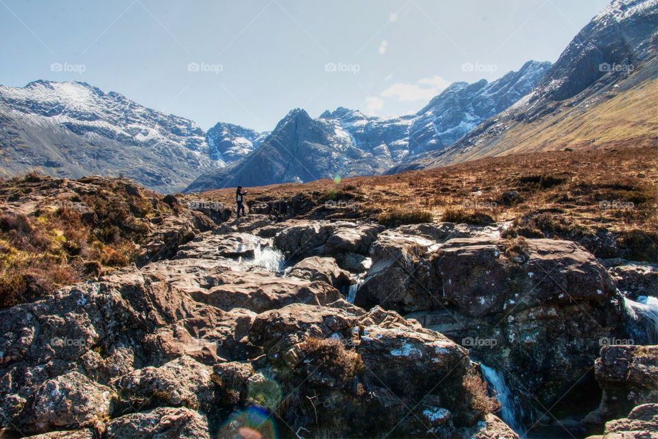 Man taking a photo of the fairy pools