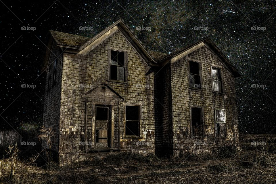 Exterior of old abandoned house at night