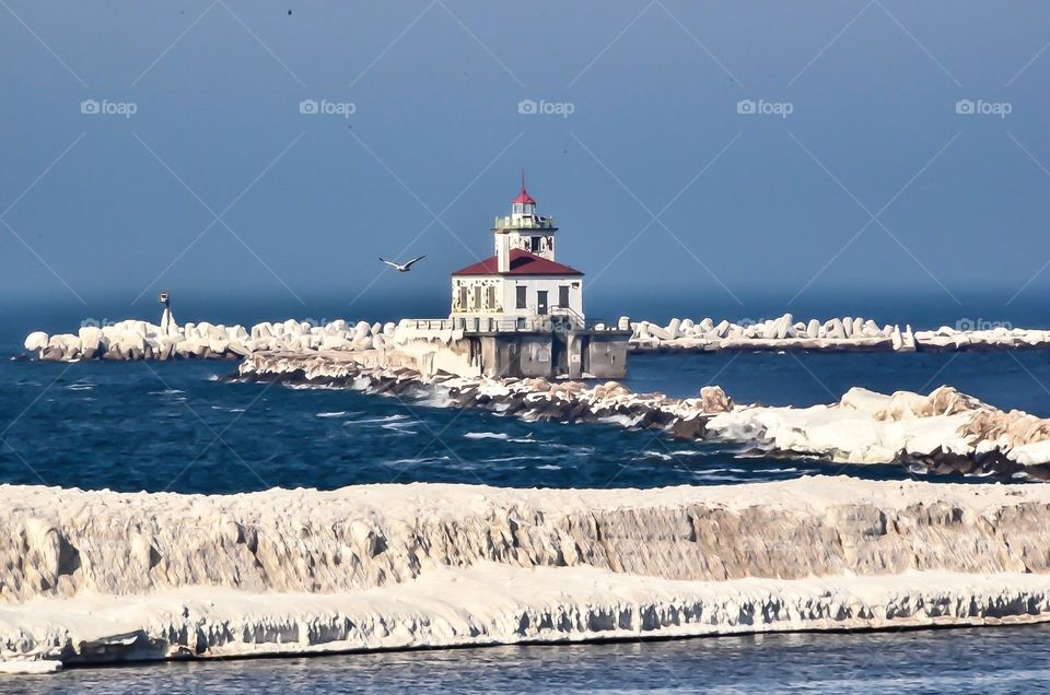 Oswego New York's lighthouse stands at the mouth of the harbor welcoming all who visit by boat during the spring, summer and fall months.