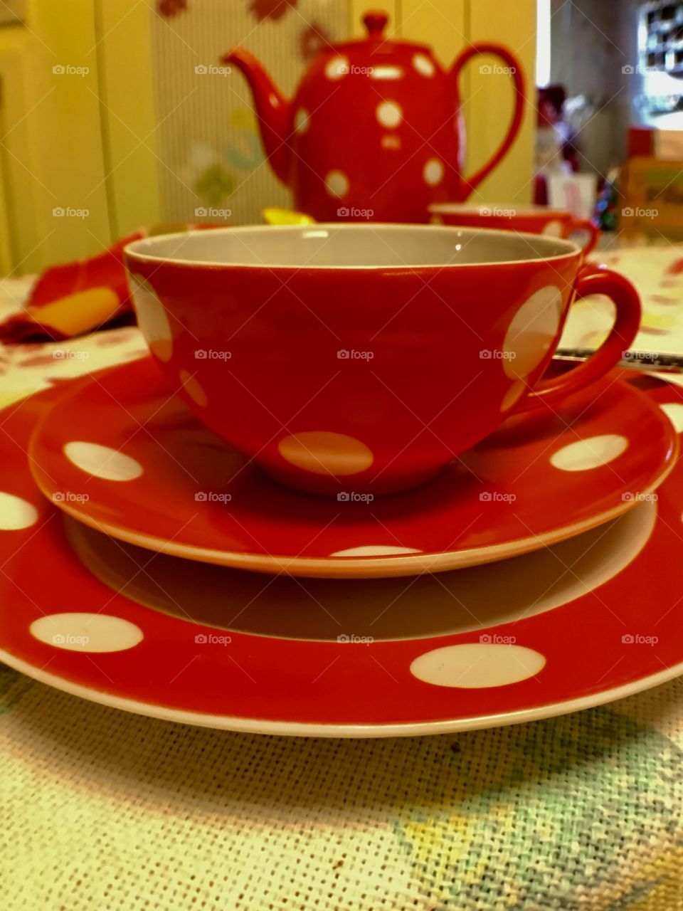 Red polkadot vintage or retro teapot, cup and saucer.