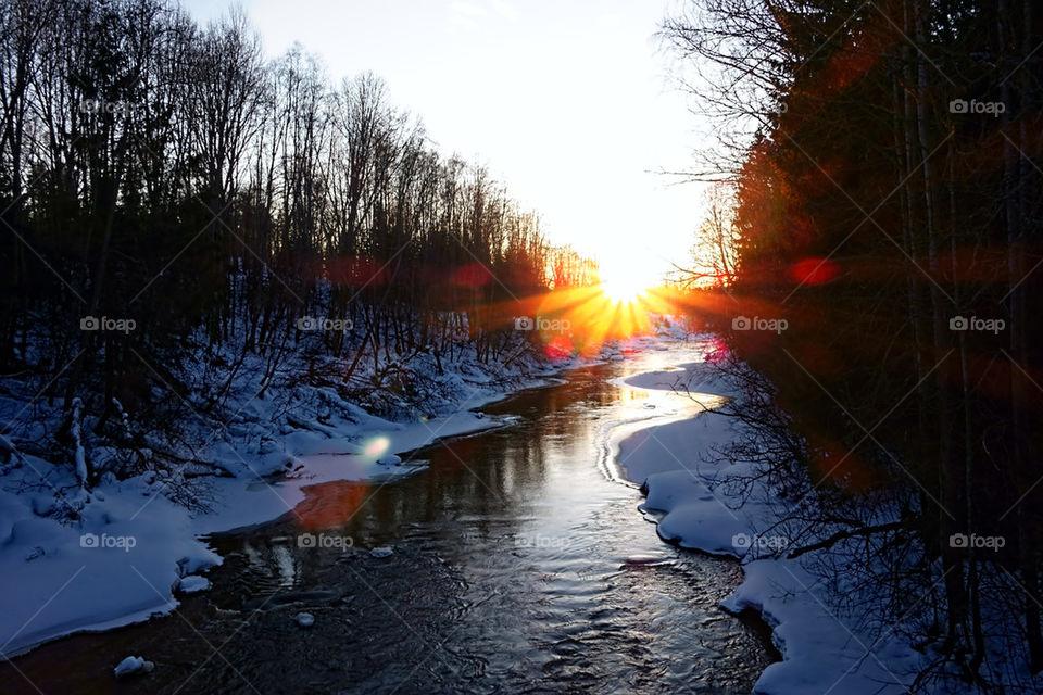 Winterly river at sundow