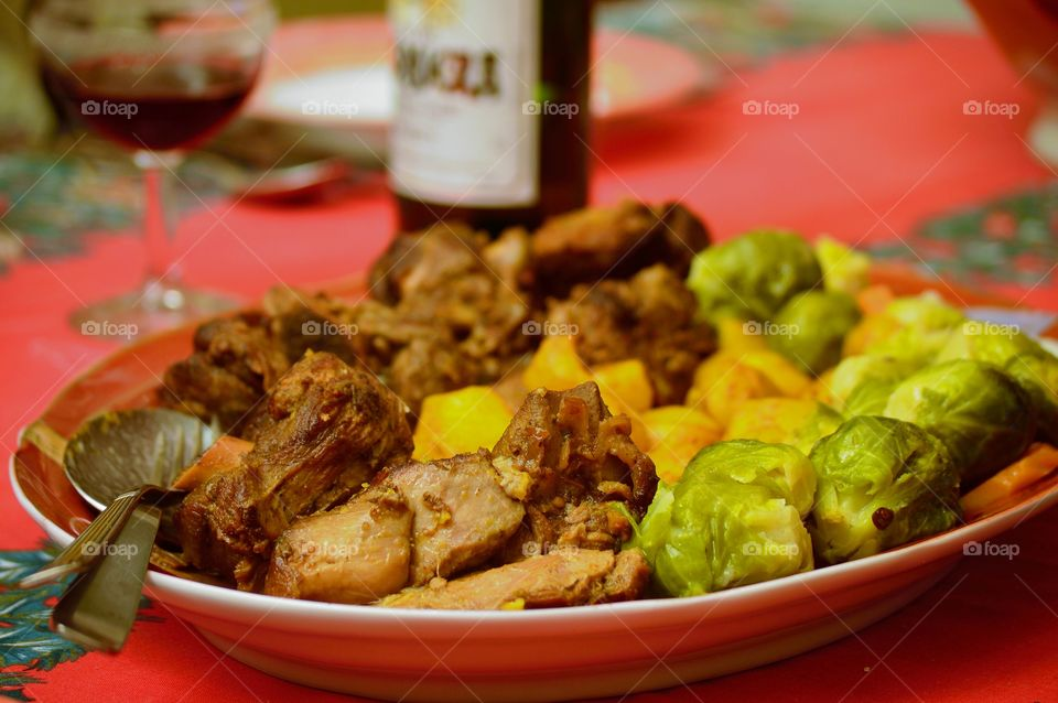Roast lamb with carrots, Brussels sprouts and new potatoes