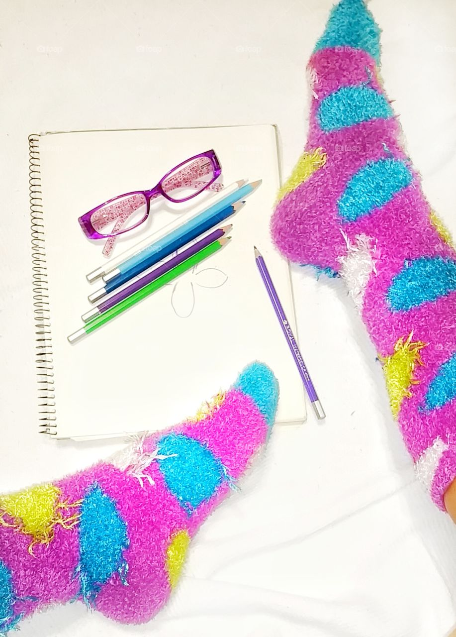 bright color socks with art supplies