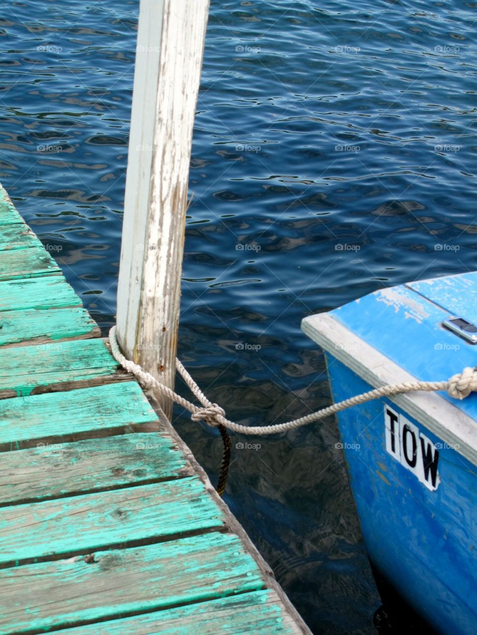 The green pontoon and the blue boat