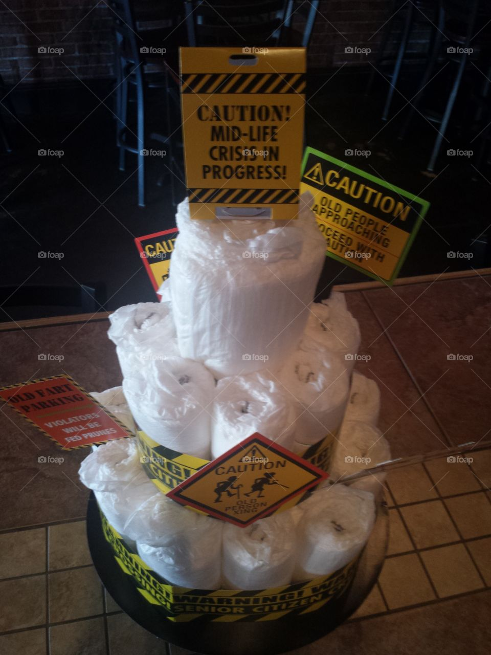 Caution sign with stack of papers