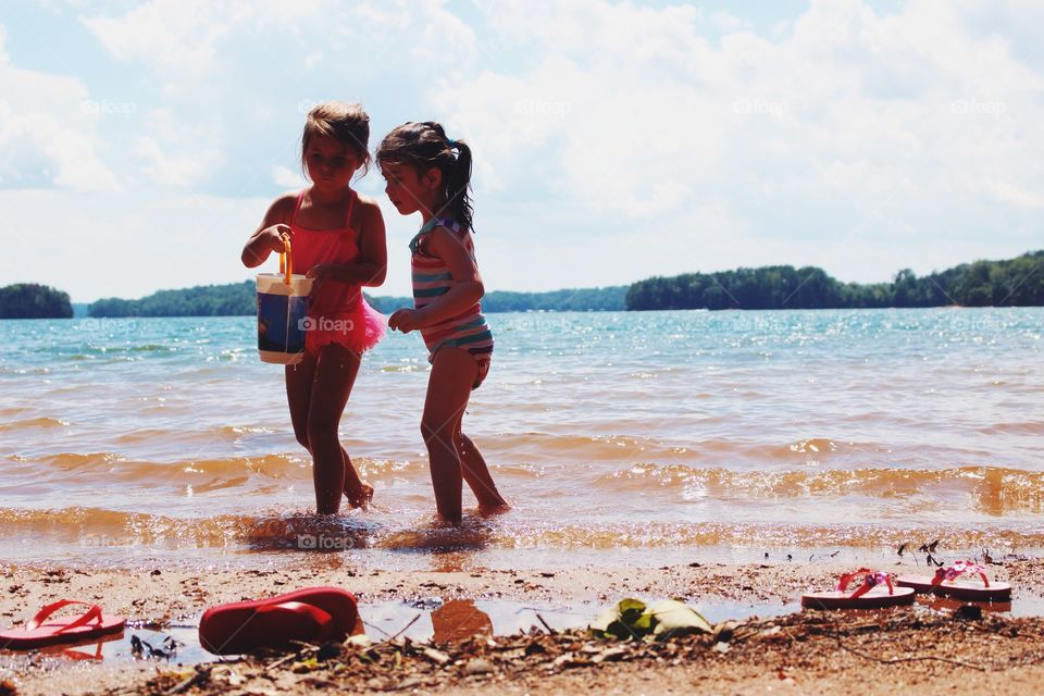 Two girls playing at beach