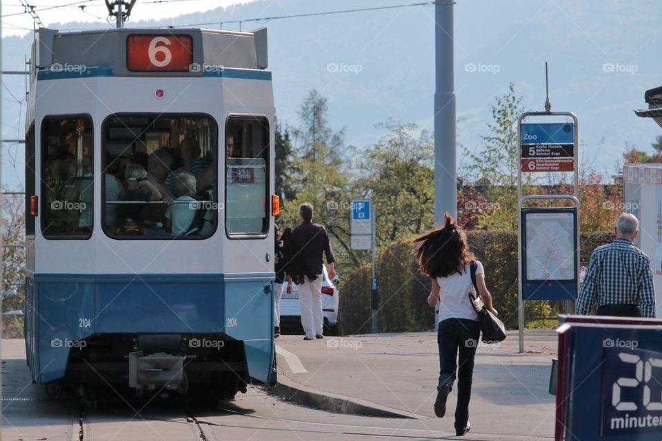 Female Running For A Tram