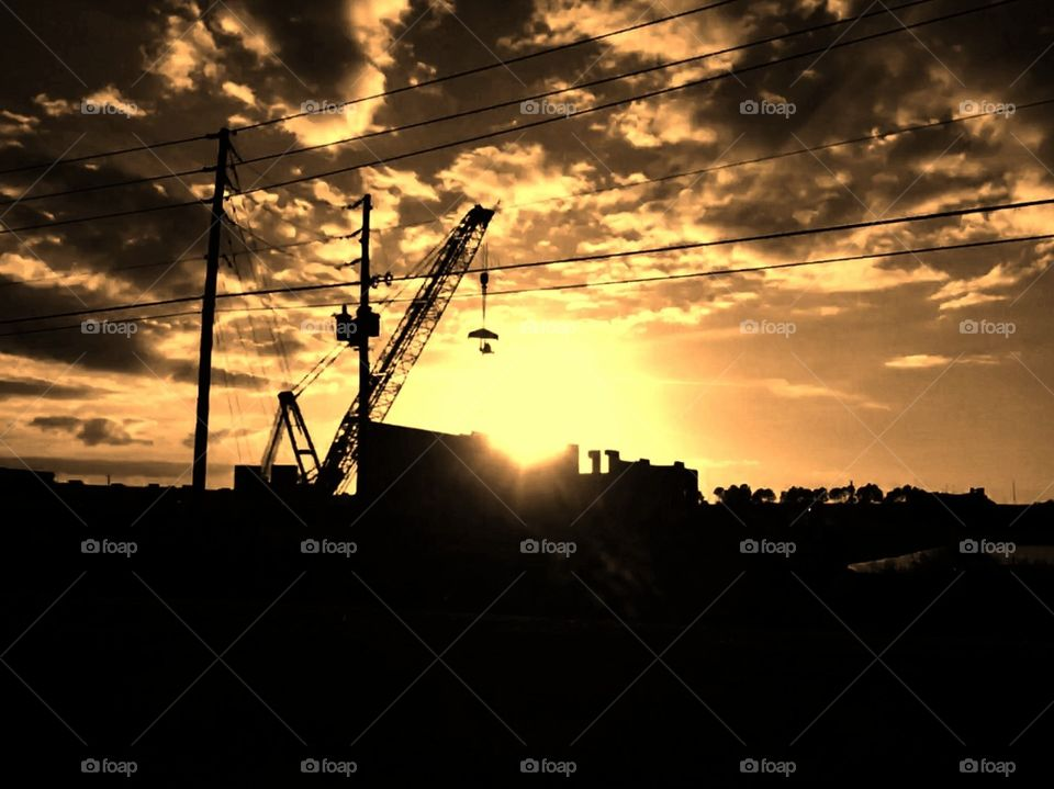 Holding up the Sun by crane in Florida on a construction site