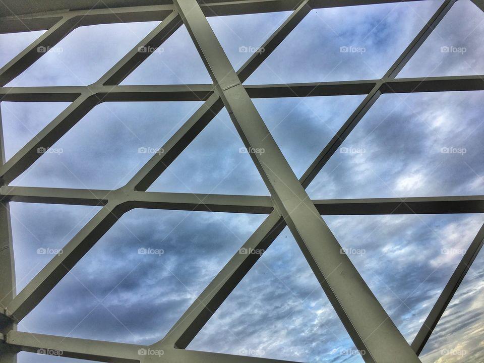 Gray bridge with cloudy sky