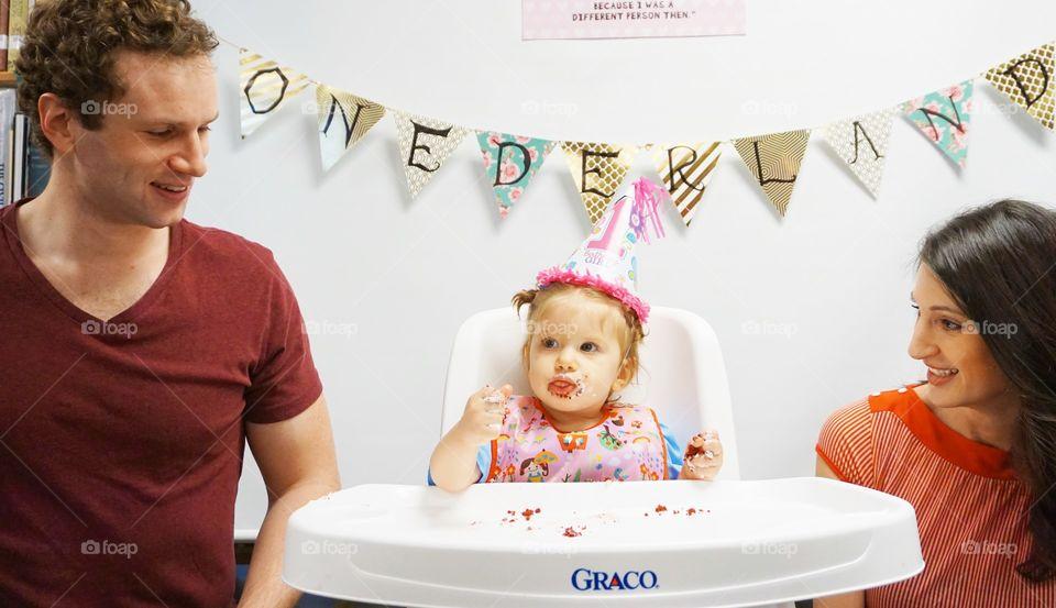 Happy family celebrating their son's birthday