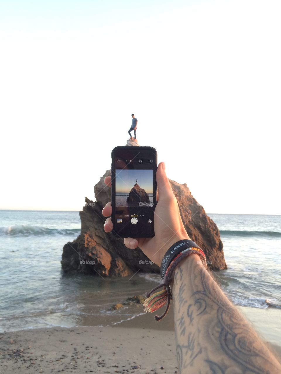 iPhone photo, guy on a rock.