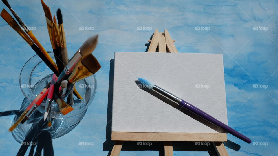 Paint brushes and canvas