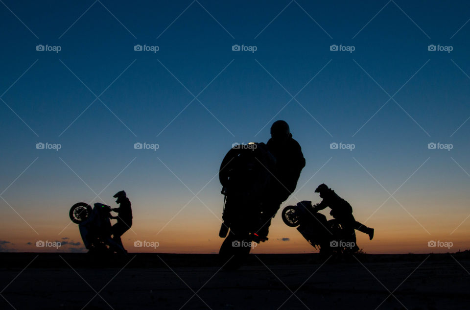 wheelies at sunrise. the guys wheeling in new mexico during early morning sunrise