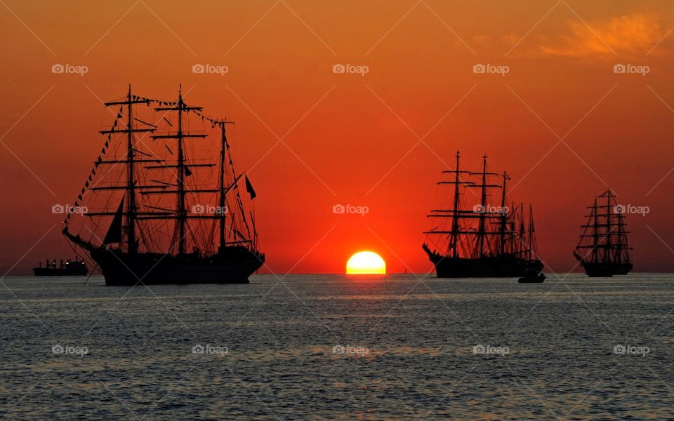 Sun and Sailboat's