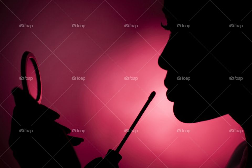 Women doing make-up | mirror, silhouette, color image, photography