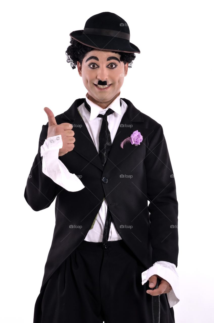 Young man dressing as Charlie Chaplin