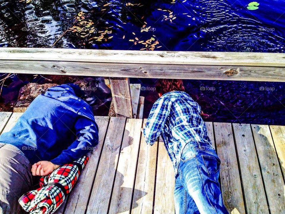 Boys exploring a Lake in Sweden