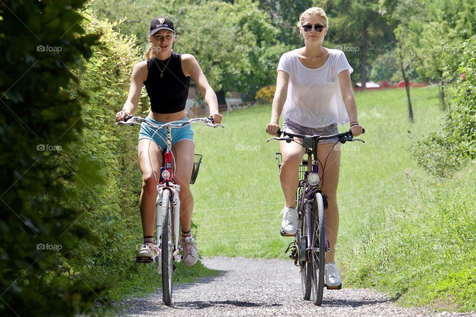 Street Photography.Girls on bikes.