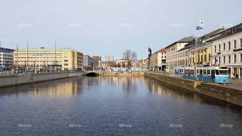 Tram and the canal moat in the city of Gothenburg Sweden - spårvagn vid kanalen Brunnsparken Göteborg Sverige