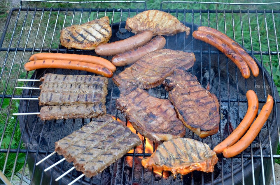 Meat and sausages on barbecue