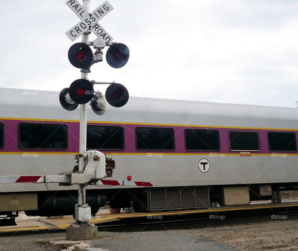 Train crossing . Commuter rail bringing home the people who work in town