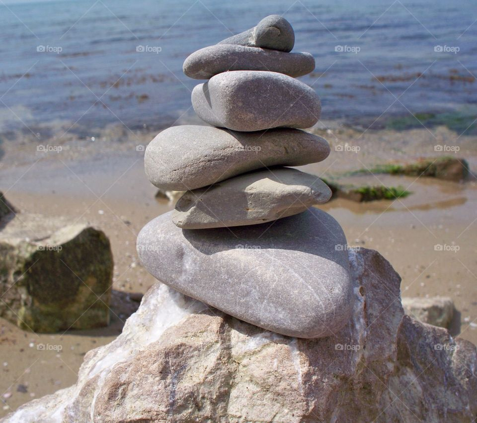 beautiful rock and pebble stack near the sea