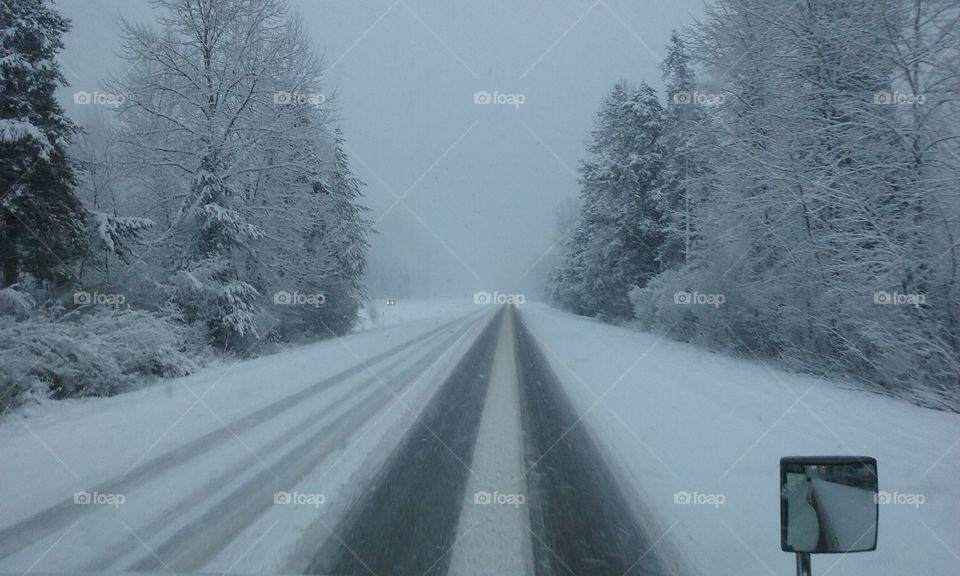 Careful Travel on dangerous icy roads in the mountains.