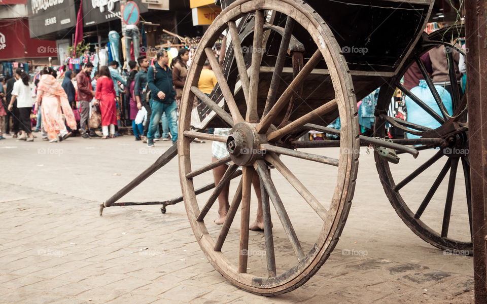 """KOLKATA, WEST BENGAL, INDIA - JANUARY 5 2019: Traditional hand pulled rickshaws, also called """" tana rickshaw"""", parked on the streets. Mode of human powered transport a runner draws a two-wheeled cart"""