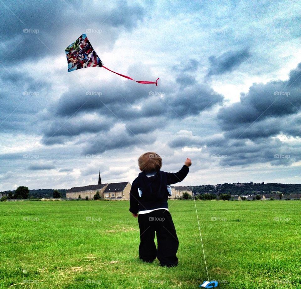 Boy flying a kite