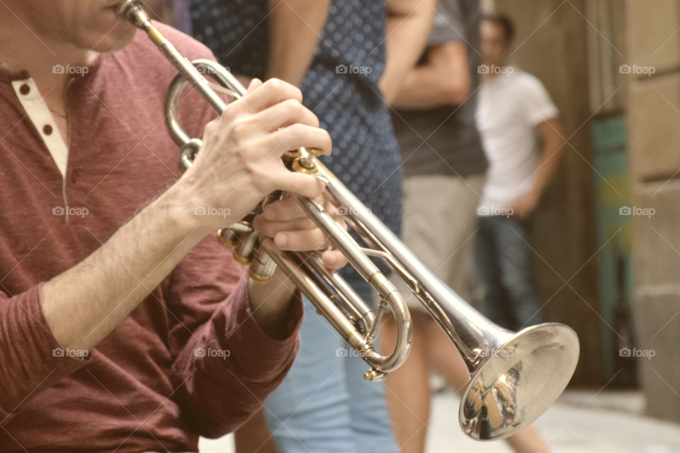 Playing the trumpet in the middle of the street