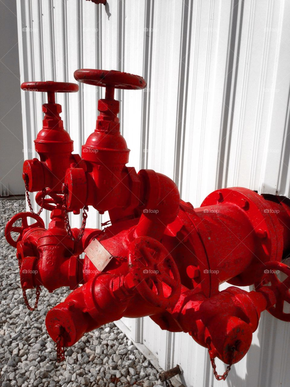 Close-up of a red industrial valve