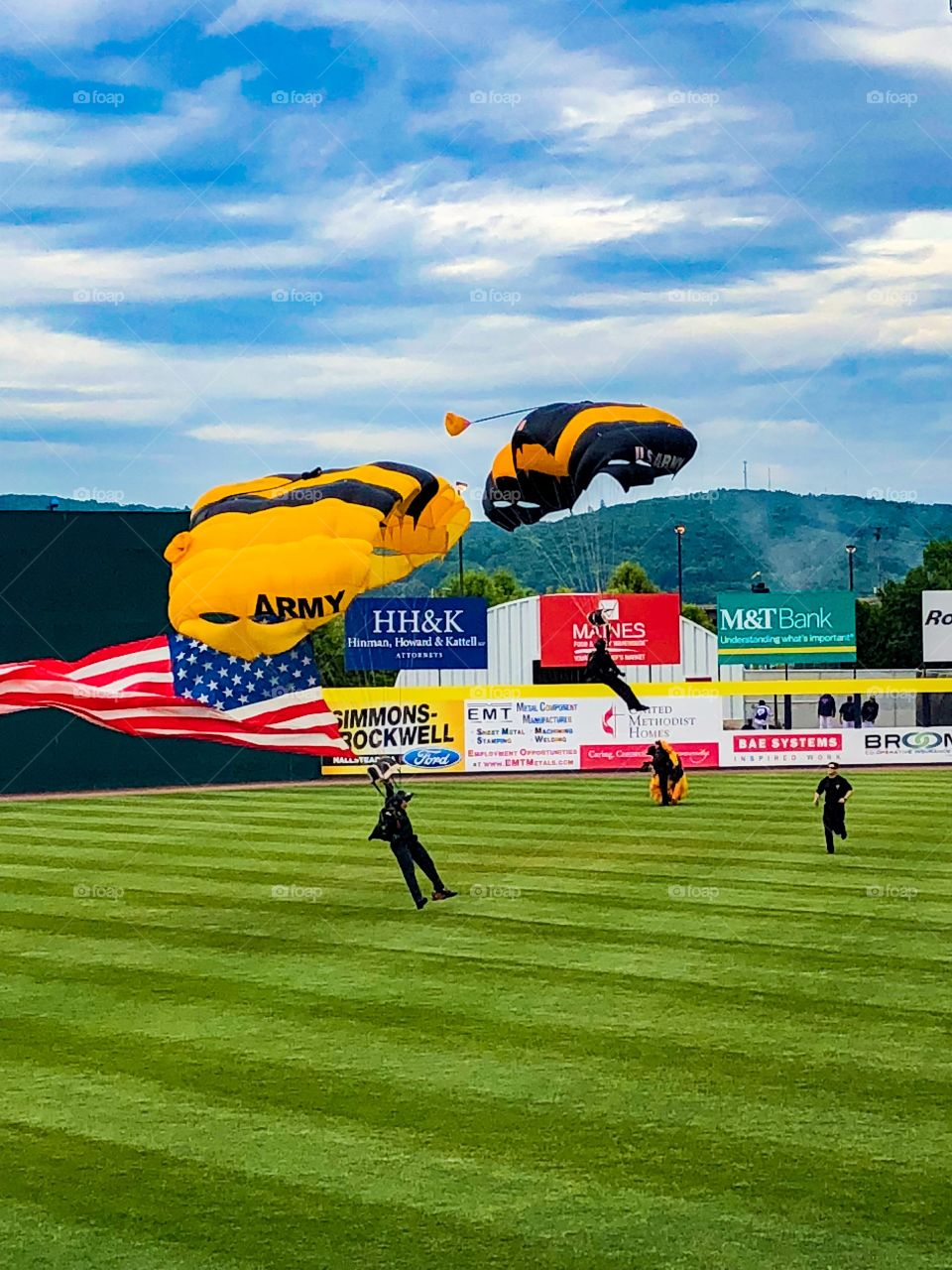 Army skydivers during national anthem at a baseball game