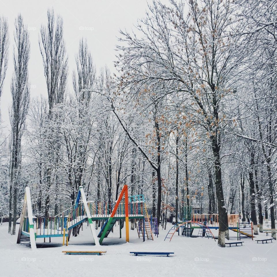 children playground in the snow