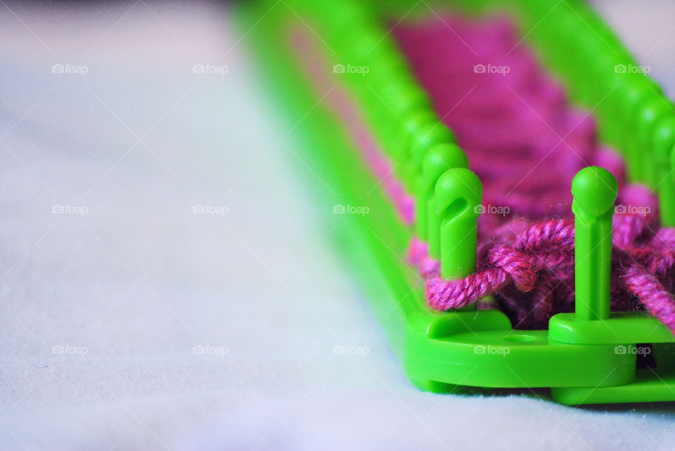 Macro shot, loom kit, yarn, pegs, knitting, diy, do it yourself, front focus, subject on the side