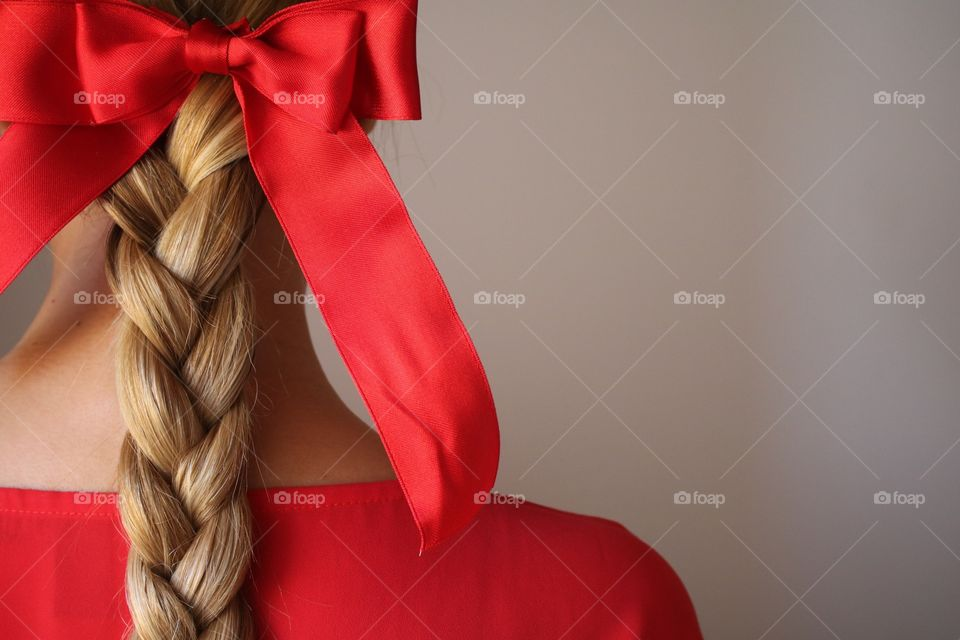 Red bow on braided hair