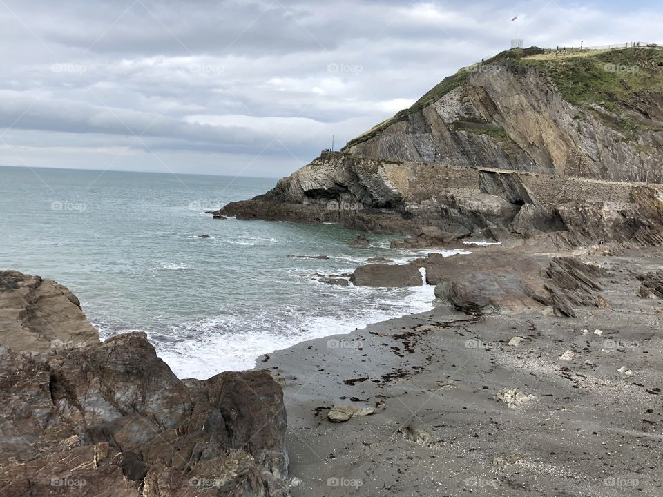 The coastline and beach at Ilfracombe, Devon on a warm but cloudy day, still a wonderful sight to enjoy.