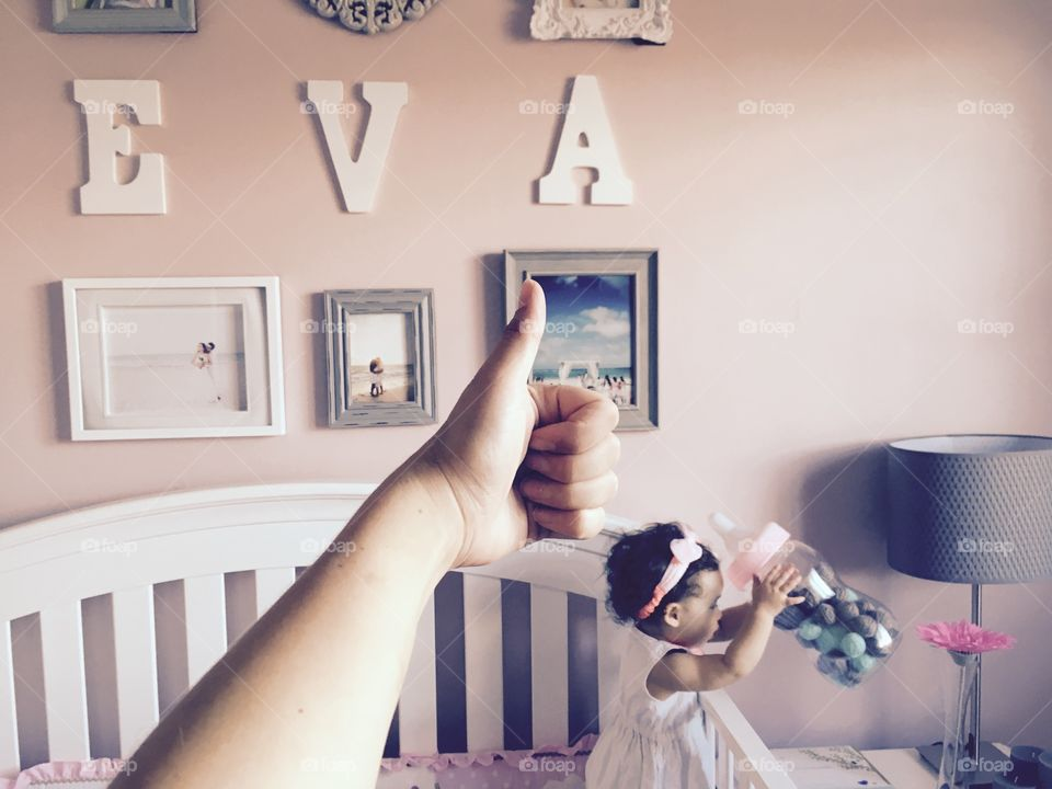 Thumbs up for been the mother of a 1 year old sweet little Eva. She was actually playing with her dolls that were hidden inside her bed . When she got tired, she looked at me for a while trying to tell me something. That's when I realized she was hungry and what a better way to show me by picking up the gigantic baby bottle close to her bed .